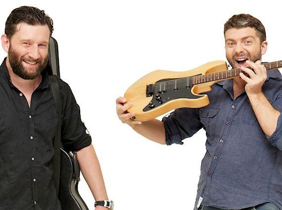 Two guys playing guitar